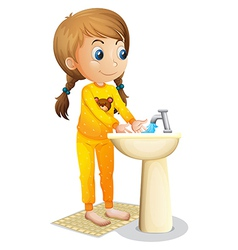 A cute young girl washing her hands vector image
