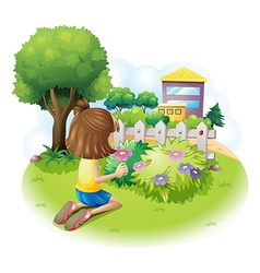 A girl picking flowers vector image