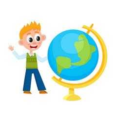 boy schoolboy looking at big school globe vector image vector image