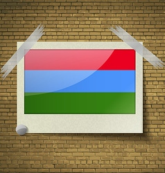 Flags karelia at frame on a brick background vector
