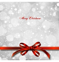 Red bow on a magical Christmas card vector image