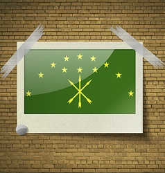 Flags adygea at frame on a brick background vector