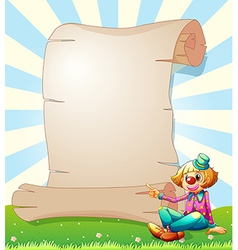 A clown beside a blank paper vector image vector image