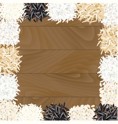 Different types of rice on wooden background vector