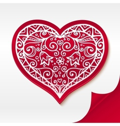 Red lacy heart on curved white paper vector image