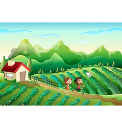 Two kids catching butterflies at the farm vector image