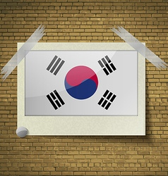 Flags korea south at frame on a brick background vector