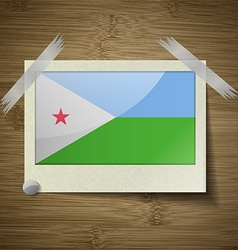 Flags djibouti at frame on wooden texture vector