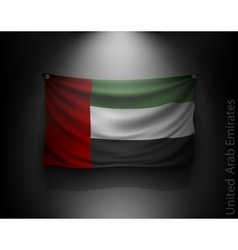 Waving flag united arab emirates on a dark wall vector