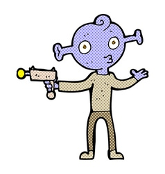 Comic cartoon alien with ray gun vector