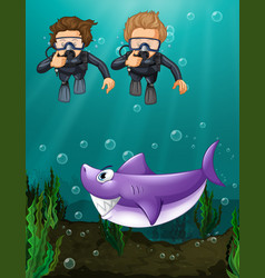 Two divers looking at shark underwater vector
