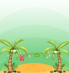 Two coconut trees with hanging clothes vector