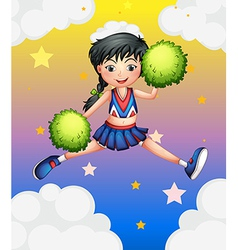 A cheerleader jumping with her green pompoms vector