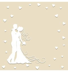 Paper silhouette of kissing bride and groom vector image