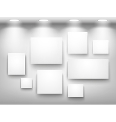 Gallery of empty frames on wall with lighting vector