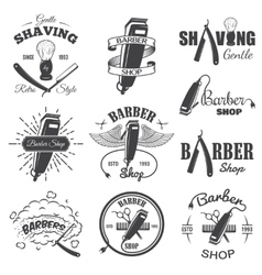 Second set of vintage barber shop emblems vector image