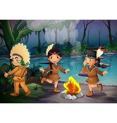 Three indian kids inside the forest vector