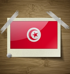 Flags tunisia at frame on wooden texture vector