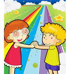 A colorful road with a girl and a boy holding vector
