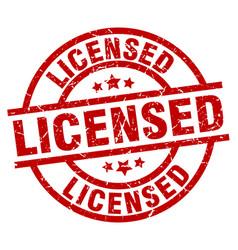 Licensed round red grunge stamp vector