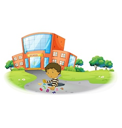A boy playing in front of the school building vector