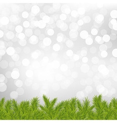 Fir tree border with silver bokeh vector