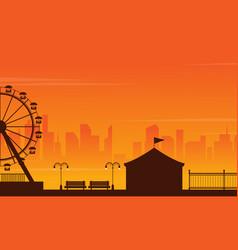 Amusement park landscape silhouette at sunset vector