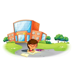 A girl writing in the hole near the school vector image