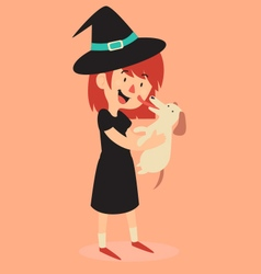 Witch standing and holding her new puppy vector