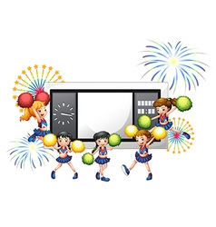 Cheerdancers with a scoreboard at the back vector image