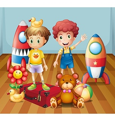 Two boys surrounded with toys vector