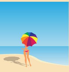 Women with umbrella on the beach vector