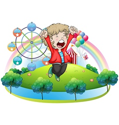 A happy boy at the carnival vector image vector image