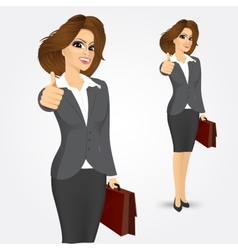 Businesswoman giving thumbs up vector