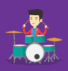 Man playing on drum kit vector