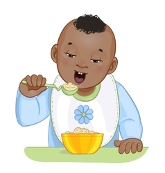 African american baby boy with spoon and plate vector