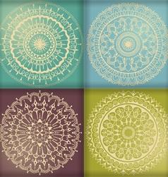 Four circular floral ornaments vector