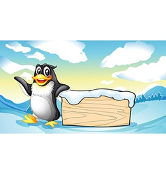 A penguin beside the empty wooden board vector