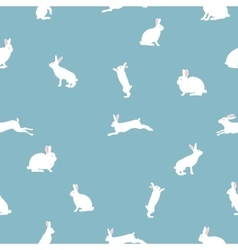 Cute rabbit seamless pattern on blue vector