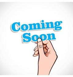 Coming soon word in hand vector