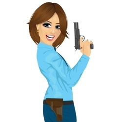 Attractive police woman holding a handgun vector