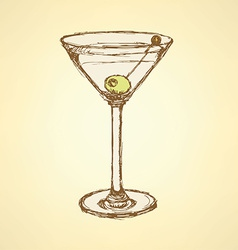 Sketch martini glass with olive vector