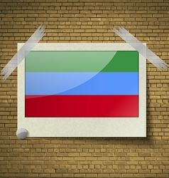 Flags dagestan at frame on a brick background vector