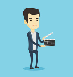 smiling man holding an open clapperboard vector image