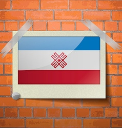 Flags mari el scotch taped to a red brick wall vector