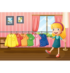 A girl beside the hanging clothes inside the house vector image