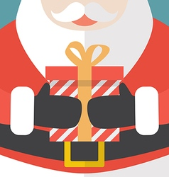 Santa Claus holding a Christmas gift vector image vector image