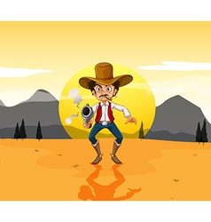 A cowboy holding a gun in the middle of the desert vector image
