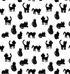 Seamless pattern black cats silhouettes on white vector