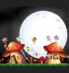 Cute fairies flying over mushroom house vector